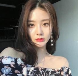 韩式微卷中长发图片 气质慵懒别有一番味道